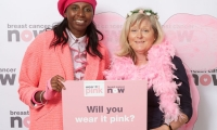 Anne Main MP poses in pink at Houses of Parliament to support Breast Cancer Now's flagship fundraiser wear it pink